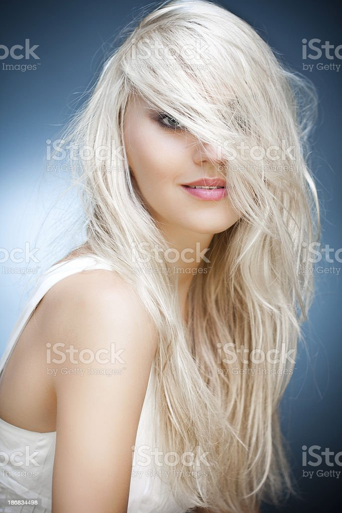 Young woman with long blonde hair covered her face royalty-free stock photo