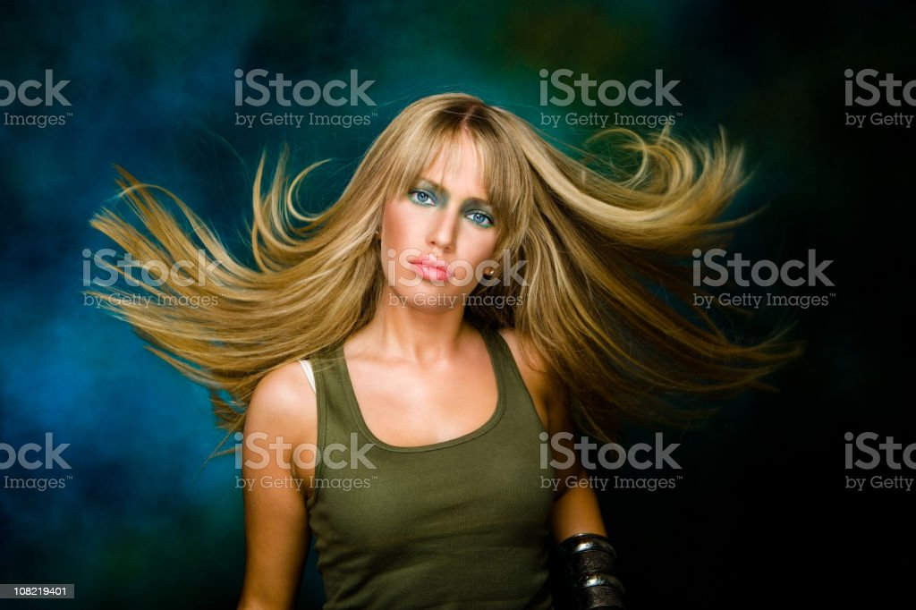 Young Woman with Long Blonde Hair Posing royalty-free stock photo
