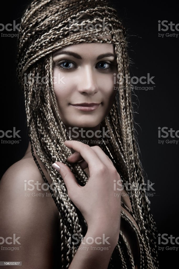 Young Woman With Long Braided Hair royalty-free stock photo