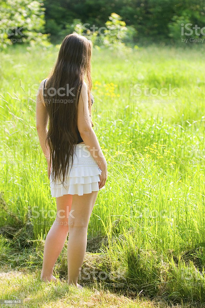 young woman with long hair contemplate the nature royalty-free stock photo