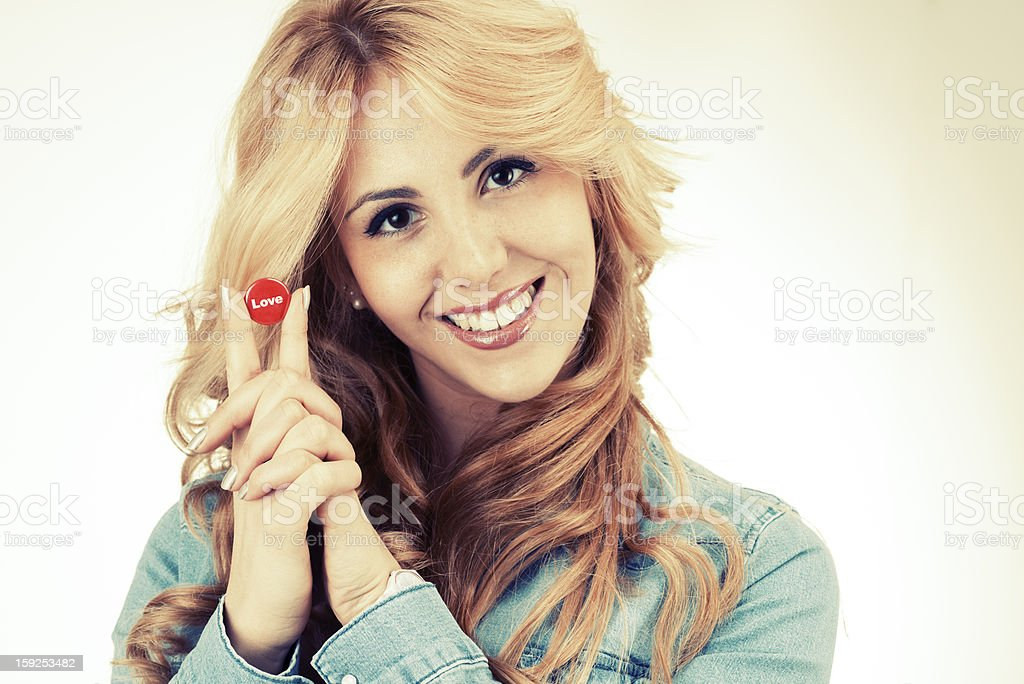 Young woman with love pin royalty-free stock photo