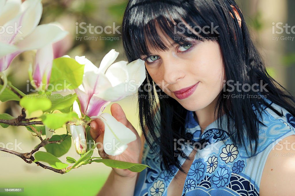 young woman with magnolia flowers royalty-free stock photo