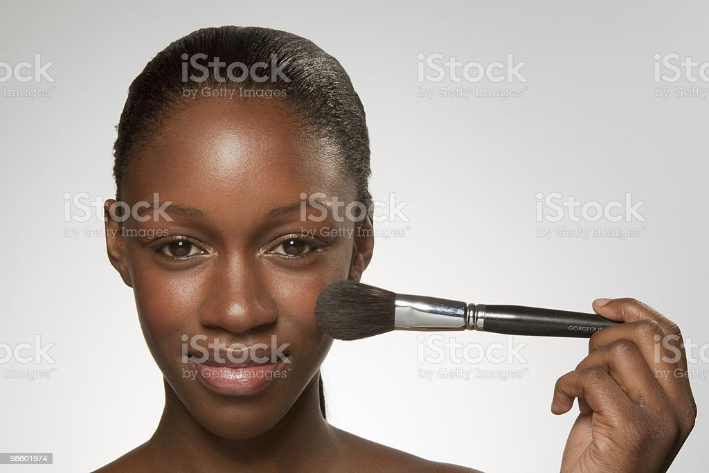 Young woman with make up brush on chick royalty-free 스톡 사진