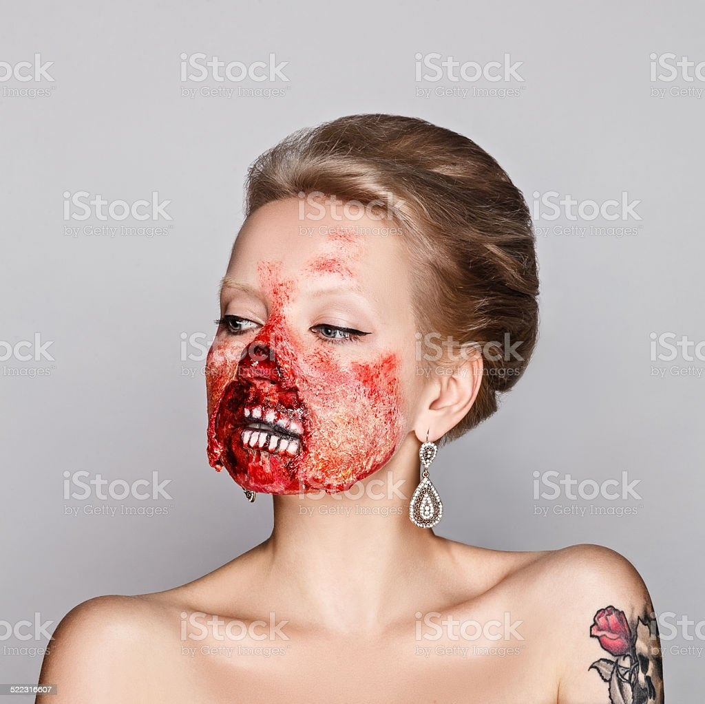 young woman with make-up zombies on Halloween in the studio stock photo