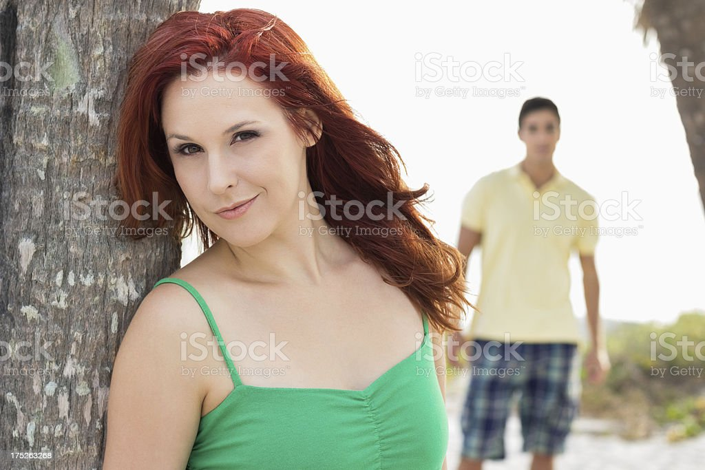Young Woman With Man At Beach. royalty-free stock photo