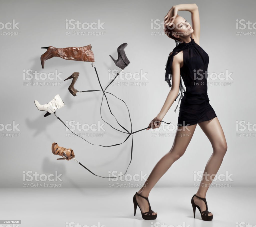Young woman with many shoes