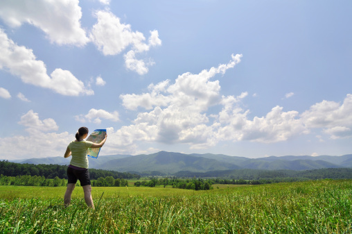 483422527 istock photo young woman with map exploring a vast wilderness 153496456