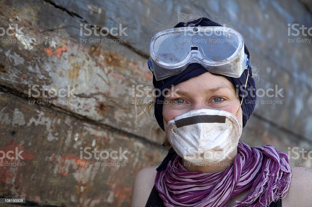 Young woman with mask and protective goggles stock photo