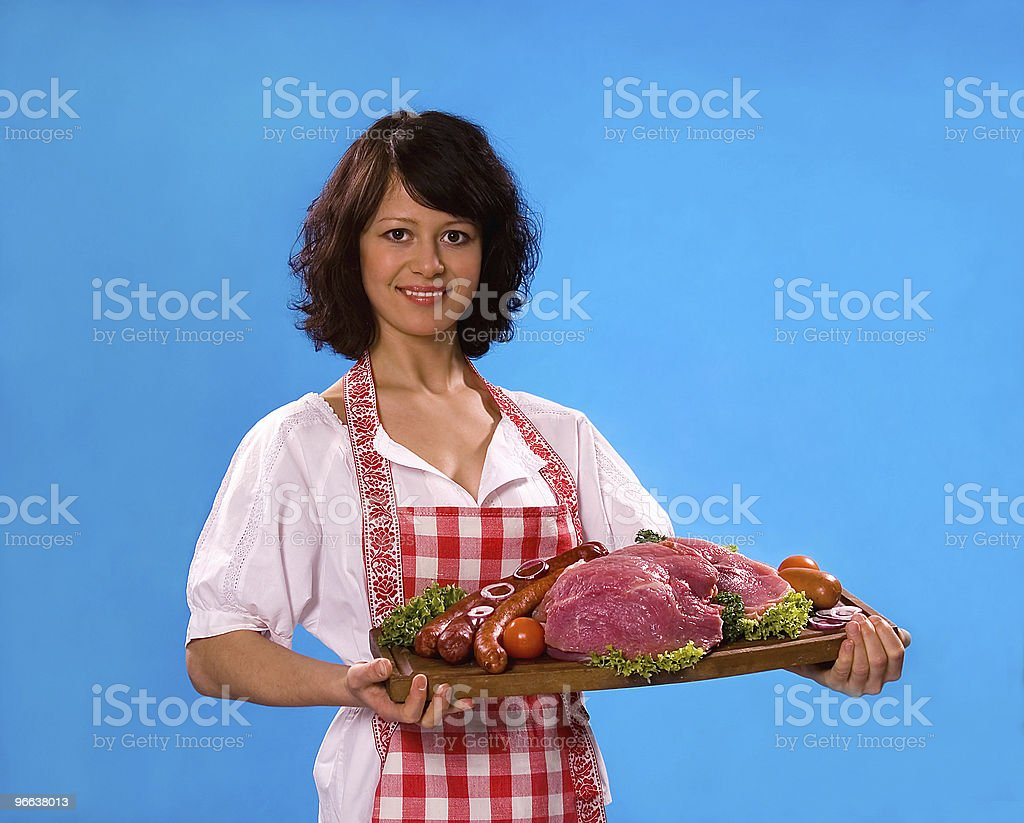 Young woman with meat products royalty-free stock photo