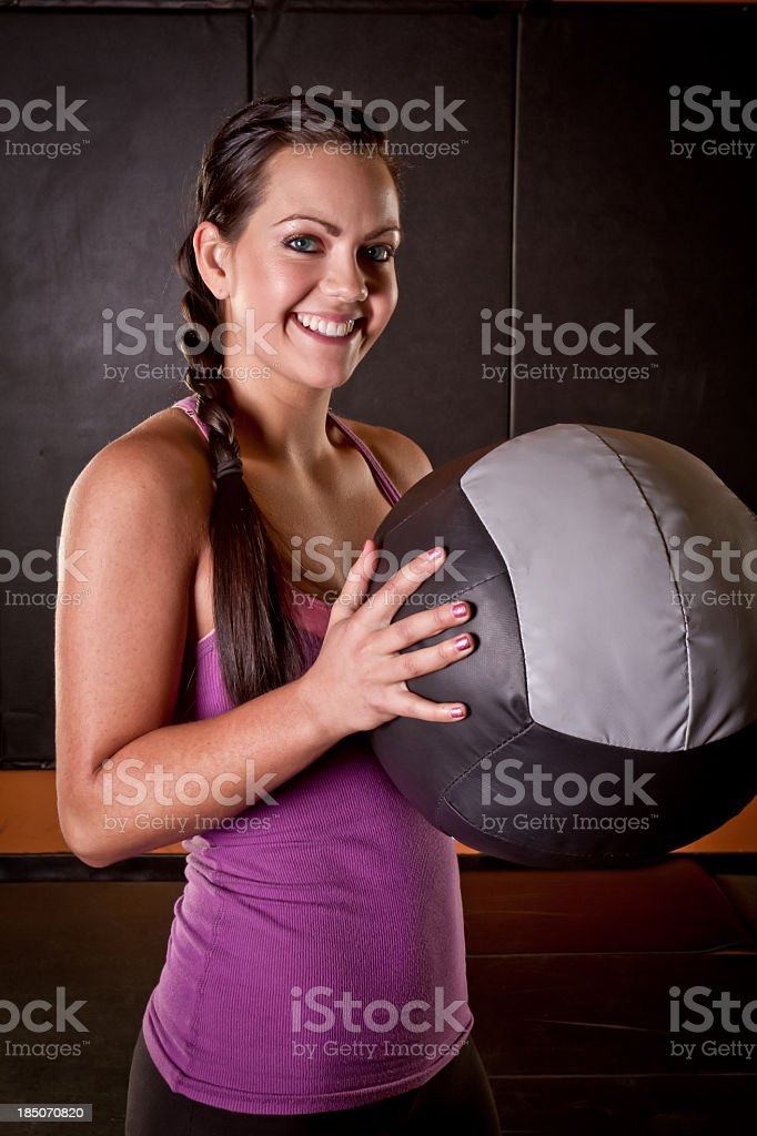 Young Woman with Medicine Ball royalty-free stock photo