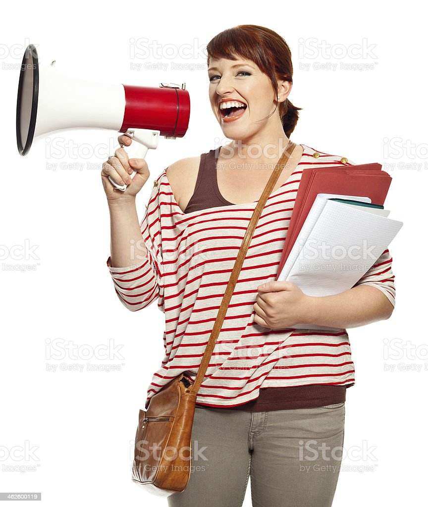 Young woman with megaphone Portrait of college student screaming into megaphone. Studio shot, white background. 20-24 Years Stock Photo