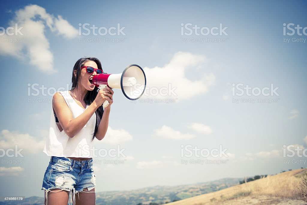 Young woman with megaphone stock photo