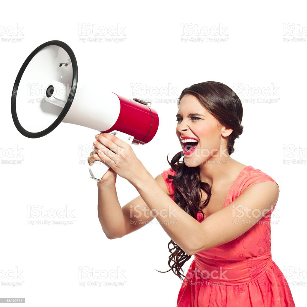 Young woman with megaphone Young woman screaming into megaphone. Studio shot, white background. 20-24 Years Stock Photo