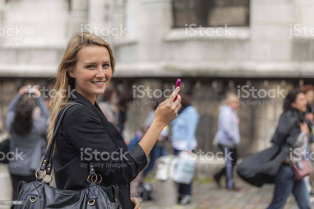 Young Woman with Mobile Phone in Montmartre stock photo