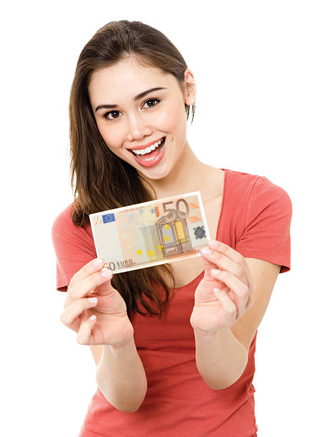 Young woman with money Young woman showing 50 euro bill happy and excited isolated on white background. fifty euro banknote stock pictures, royalty-free photos & images