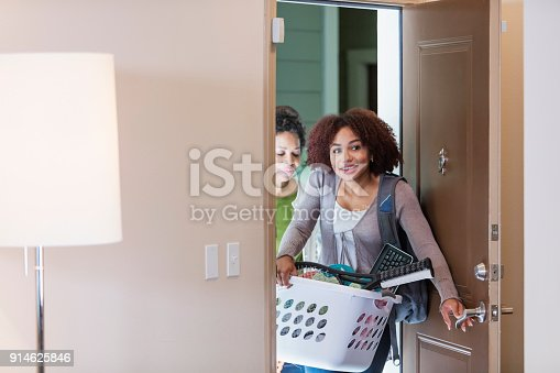 istock Young woman with mother, moving into apartment 914625846