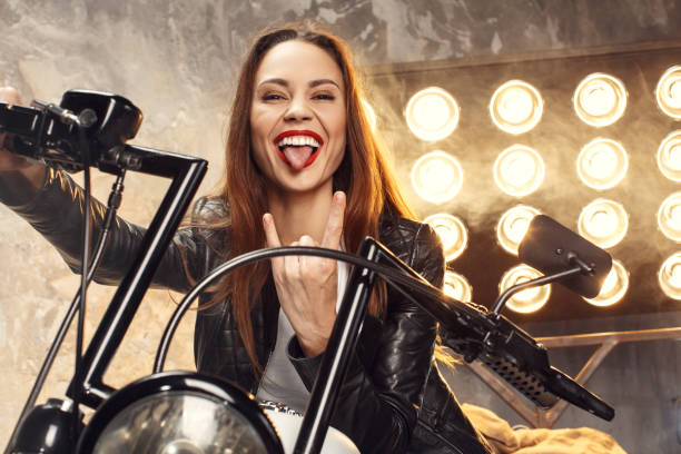 Young woman with motorcycle studio stock photo