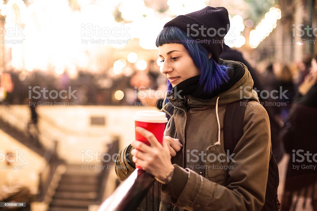 Young woman with mug in the city - Photo