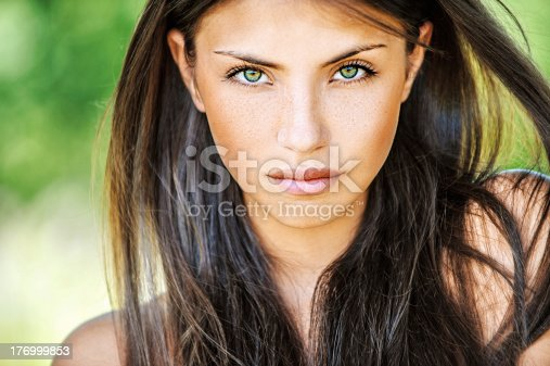 istock Young woman with multicolored eyes 176999853