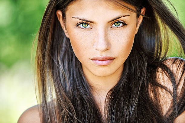 Young woman with multicolored eyes stock photo