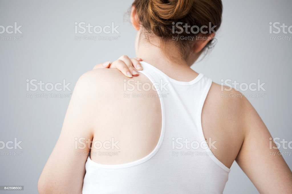 Young woman with neck ache stock photo