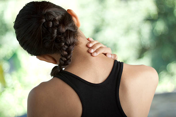 Young woman with neck pain Young woman in sportswear with neck pain. You may also like: human neck stock pictures, royalty-free photos & images