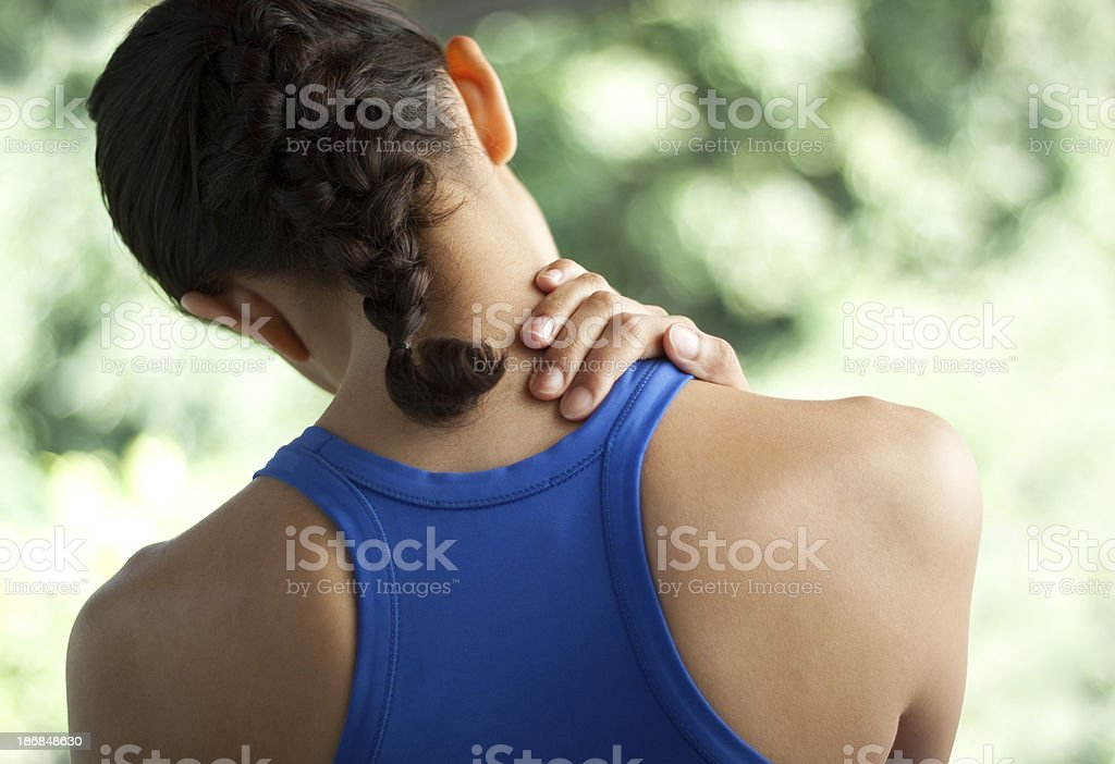 Young woman with neck pain stock photo