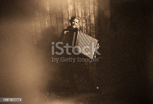 Young Woman with old Accordion