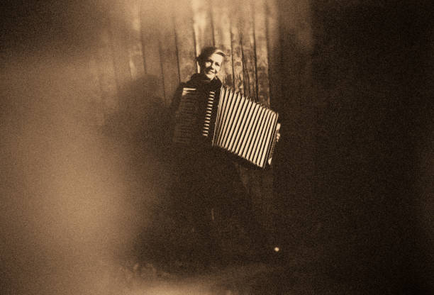 Young Woman with old Accordion stock photo