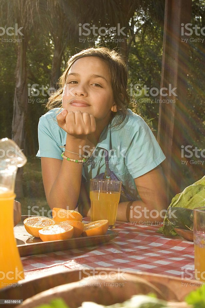 Young woman with oranges smiling in the sun royalty-free stock photo