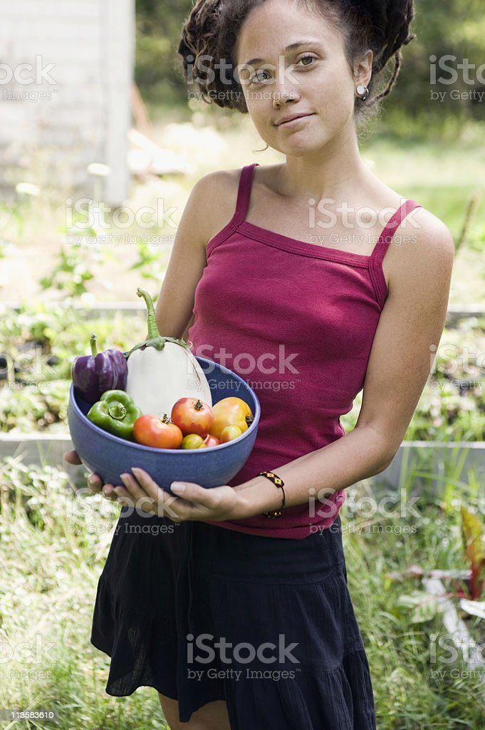 young woman with organic vegetables stock photo