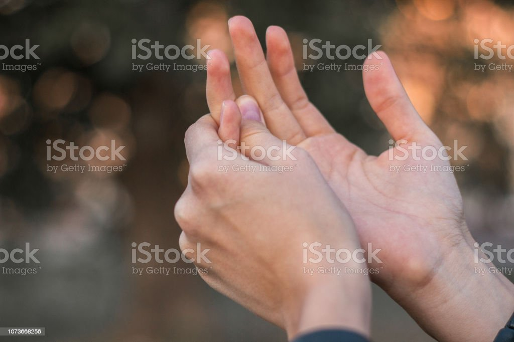 Young woman with pain on finger stock photo