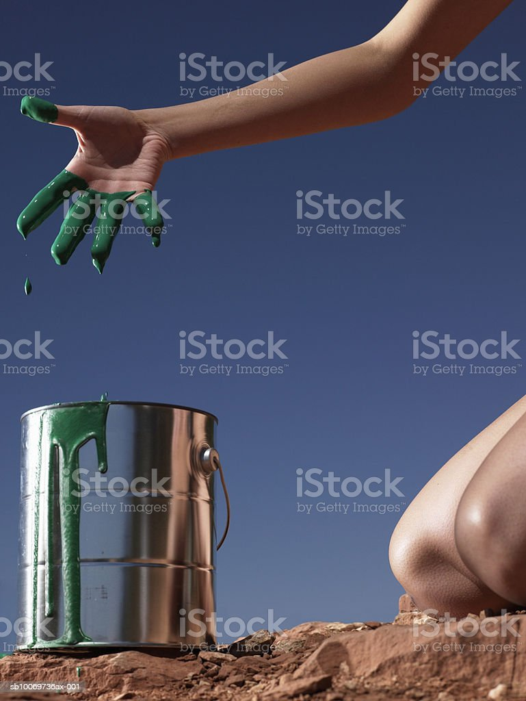 Young woman with paint on fingers, close-up royalty free stockfoto
