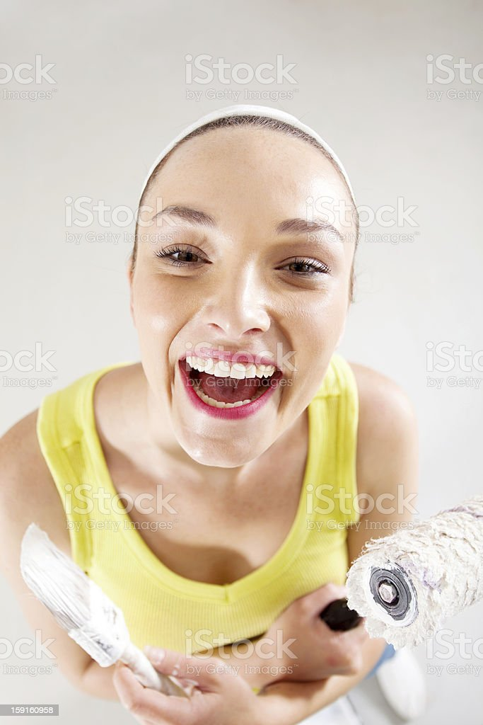 young woman with paintbrush and roller royalty-free stock photo