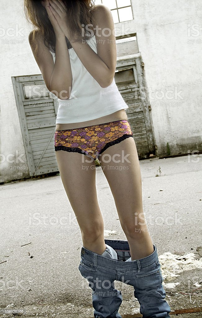 Young Woman with Pants Down stock photo