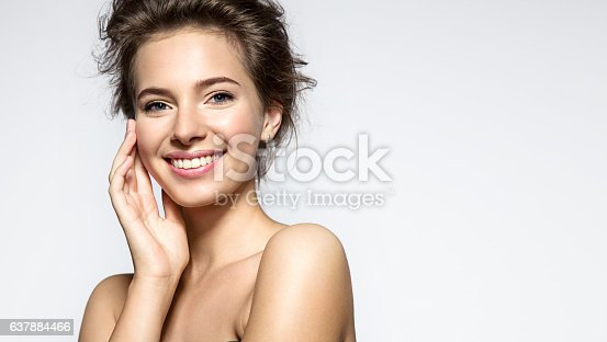 istock Young woman with perfect skin clean and white teeth 637884466