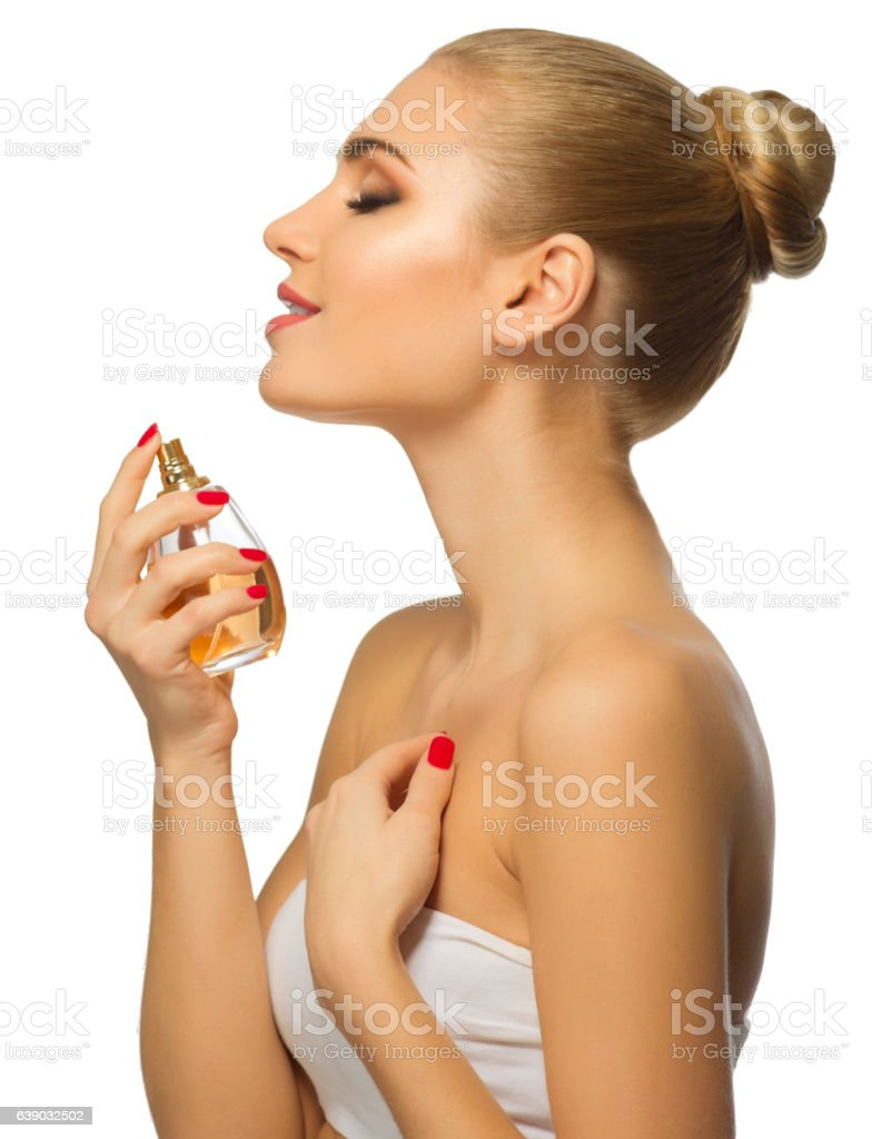 Young woman with perfume stock photo