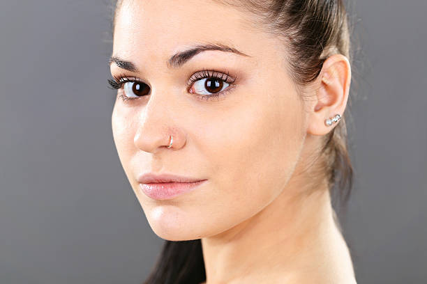 young woman with piercing - nose ring stock pictures, royalty-free photos & images