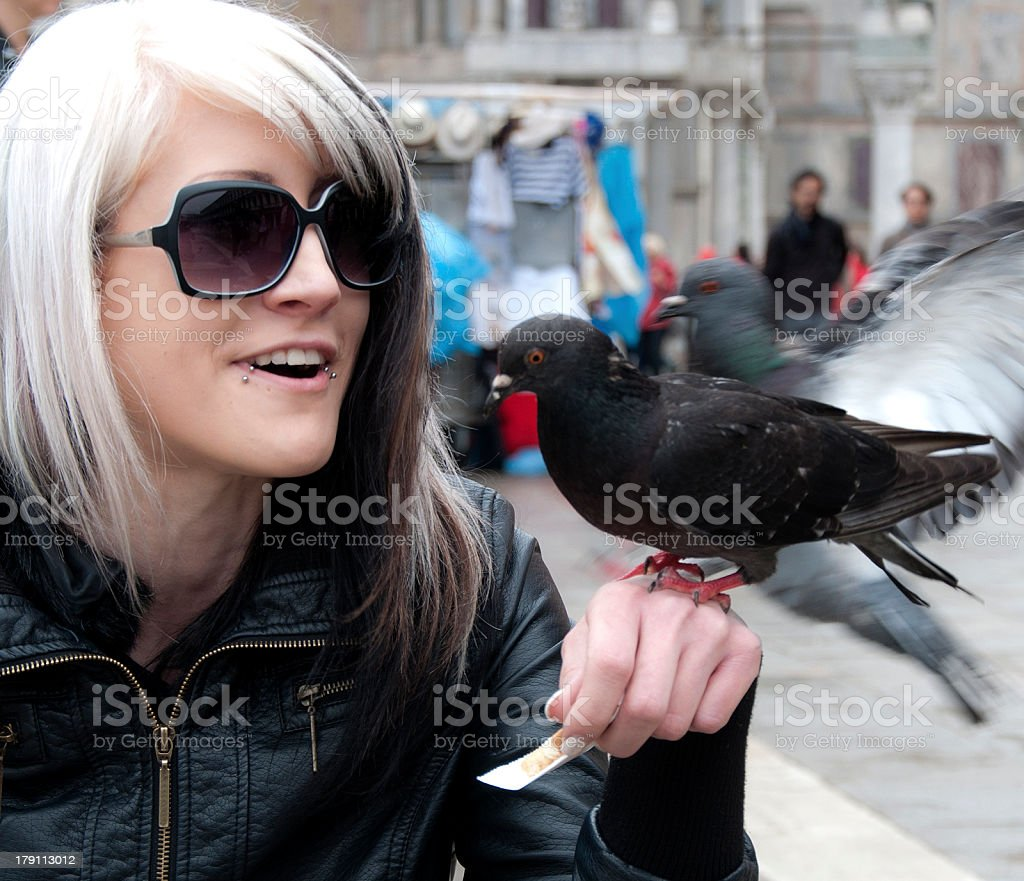 Young woman with pigeon royalty-free stock photo