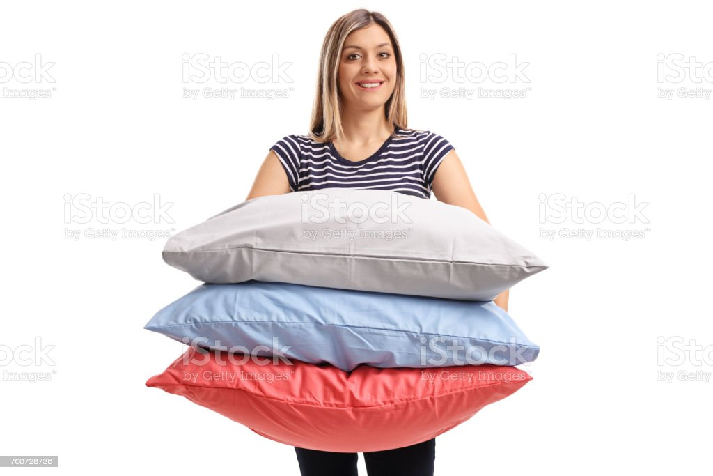 Young woman with pillows stock photo