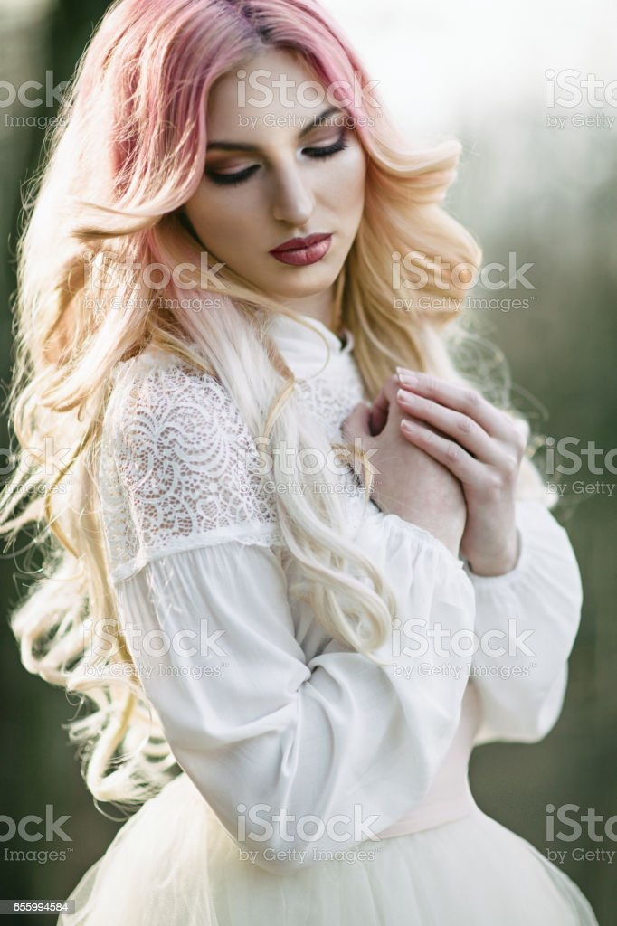 Young woman with pink hair outdoors stock photo