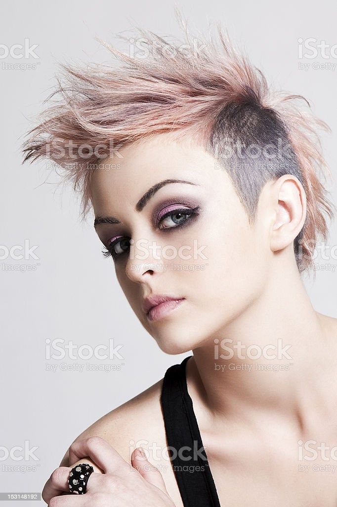 Young woman with pink punk hairstyle stock photo