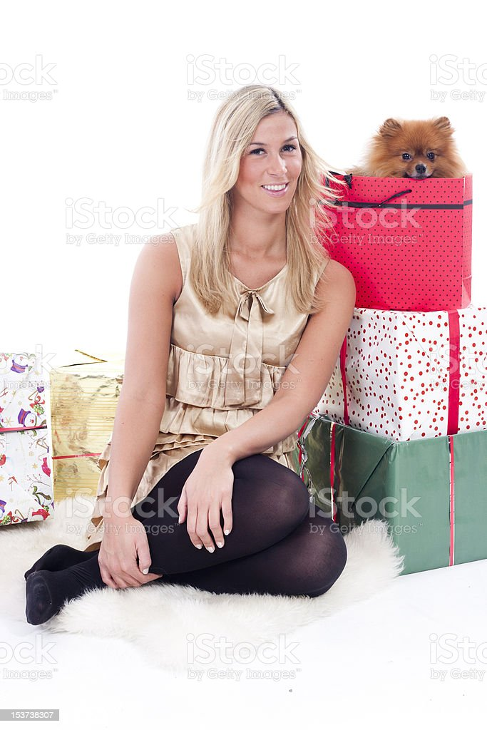 young woman with presents and a pomeranian dog royalty-free stock photo