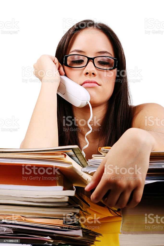 Young woman with problems and stress in the office royalty-free stock photo