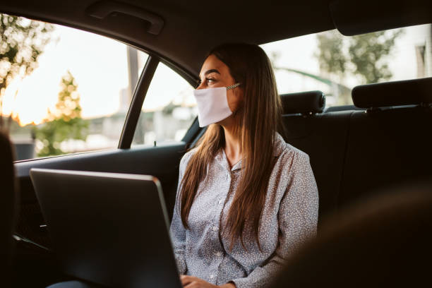Young woman with protective mask stock photo