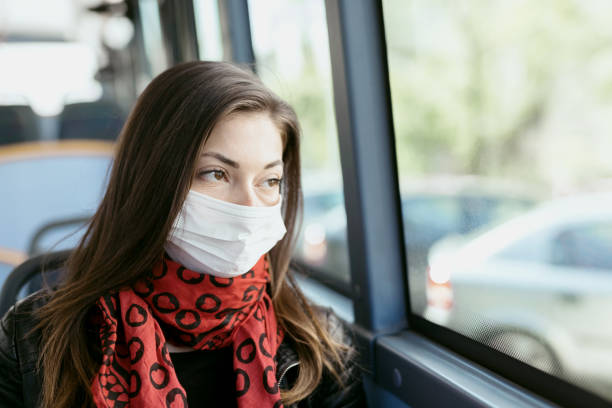 Young woman with protective mask stock image