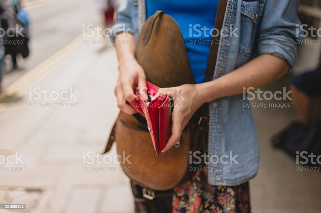 Young woman with purse in the street stock photo