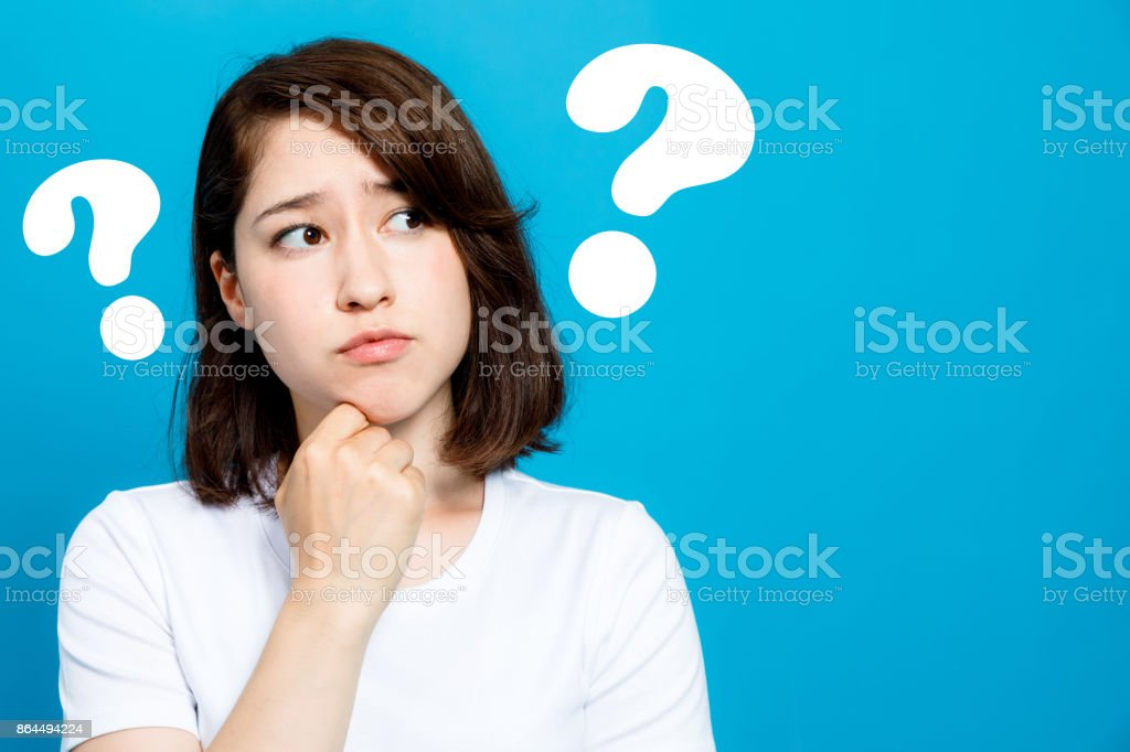 young woman with question marks. stock photo