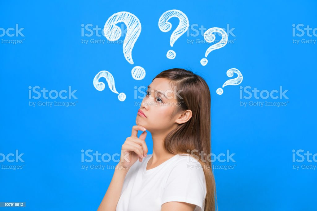 young woman with question marks. royalty-free stock photo