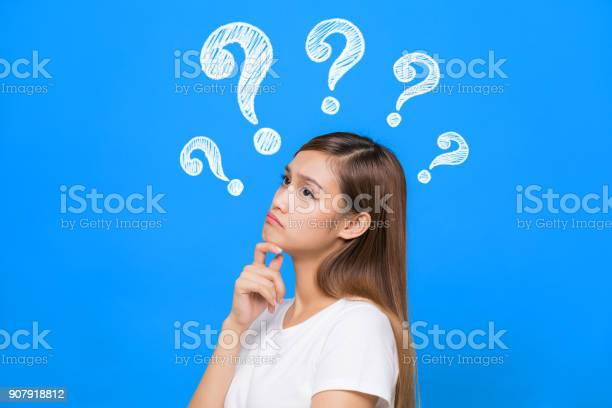 Young woman with question marks picture id907918812?b=1&k=6&m=907918812&s=612x612&h=umpwzm gb8i868vhm q8korbsl 4o9scmmel9xuren4=
